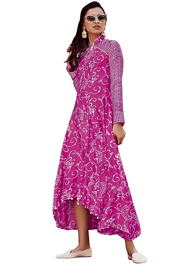 Pink printed suit with fancy hem line matched with white pants