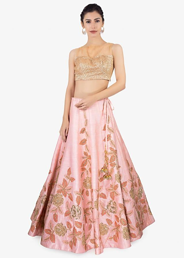 Pink raw silk lehenga paired with net dupatta and an unstitched embroidered blouse only on Kalki