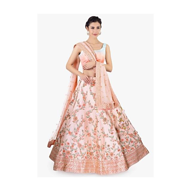 Pink  raw silk lehenga set paired with a matching net dupatta only on Kalki