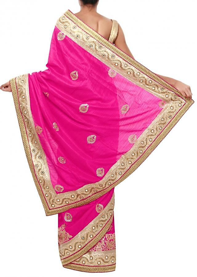 Pink raw silk saree featuring in kundan and mirror embroidery only on Kalki