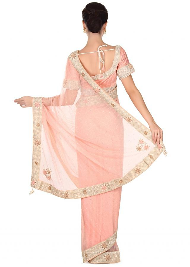 Plush pink saree adorn in 3D flower and pearl border only on Kalki