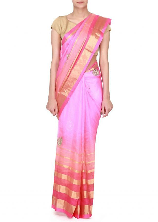 Pink saree adorn in embroidered butti all over only on Kalki