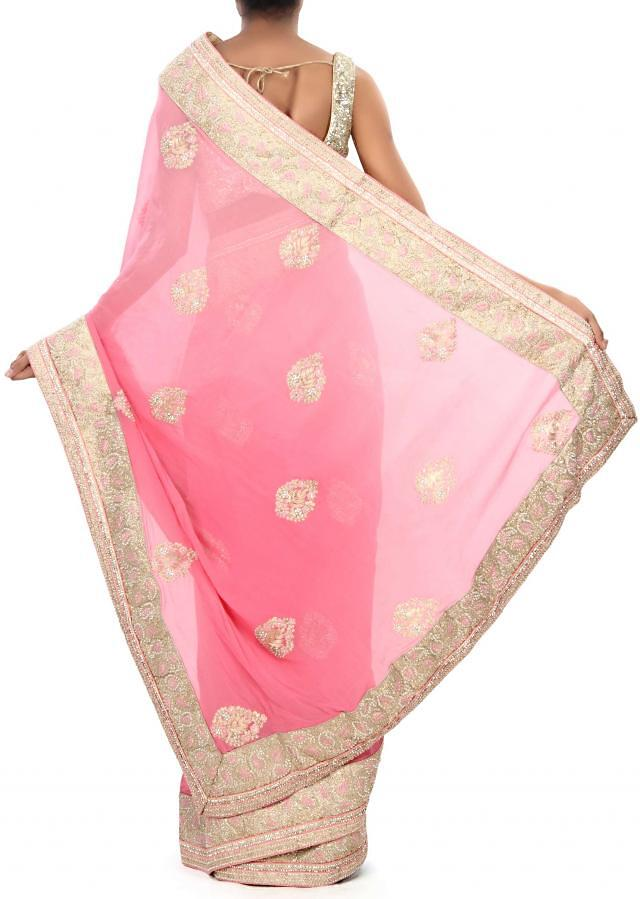 Pink saree adorn in pearl and zari embroidery only on Kalki