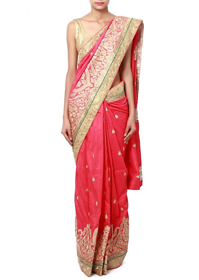 Pink saree adorn in resham and zari embroidery only on Kalki