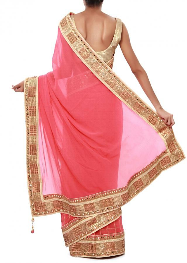 Pink saree adorn in sequin and zari embroidery only on Kalki