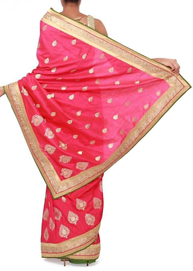 Pink saree adorn in zari embroidered butti only on Kalki