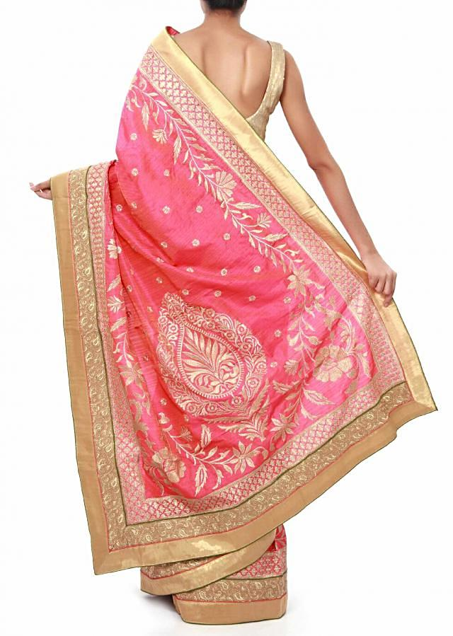 Pink saree adorn in zari weave embroidery only on Kalki