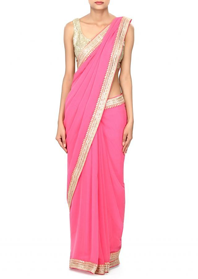 Pink saree enhanced in gold lace border only on Kalki