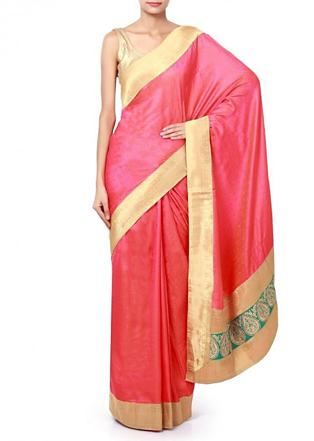 Pink saree enhanced in orange weave embroidery only on Kalki