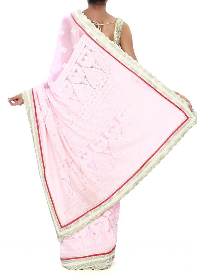 Pink saree enhanced in thread paisley motif only on Kalki