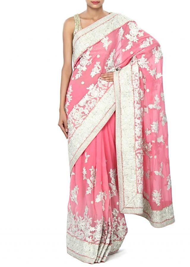 Pink saree enhanced in zari and kundan embroidery only on Kalki