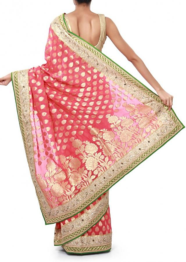 Pink saree enhanced in zari weave embroidery only on Kalki