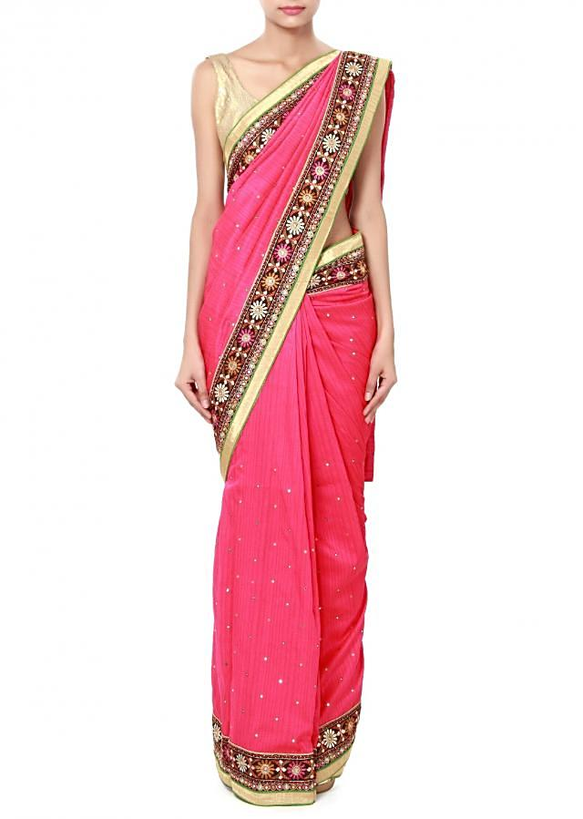 Pink saree features with embroidered border in resham and mirror only on Kalki