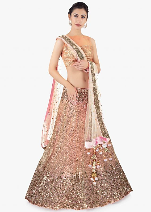 Pink sequins embroidered lehenga set paired with a matching net dupatta only on Kalki