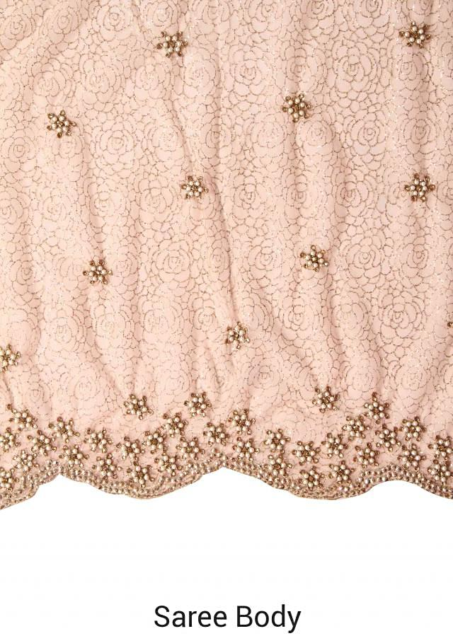 Pink shimmer saree adorn in pearl and motif embroidery only on Kalki