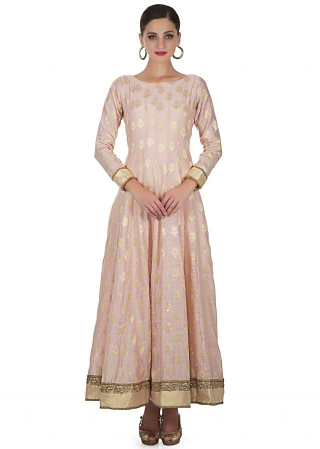 Pink Silk Flared Top and Dupatta Adorned with Golden Ethnic Motifs and Lycra Churidar only on Kalki