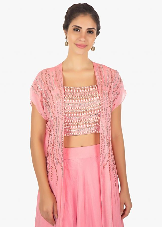 Pink sleeveless top embossed in  moti and zardosi paired with a crepe jacket in cut dana and tassel motifs only on Kalki