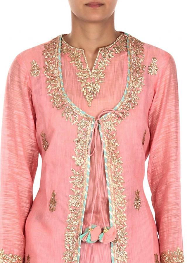 Pink straight suit adorn in zari embroidery only on Kalki
