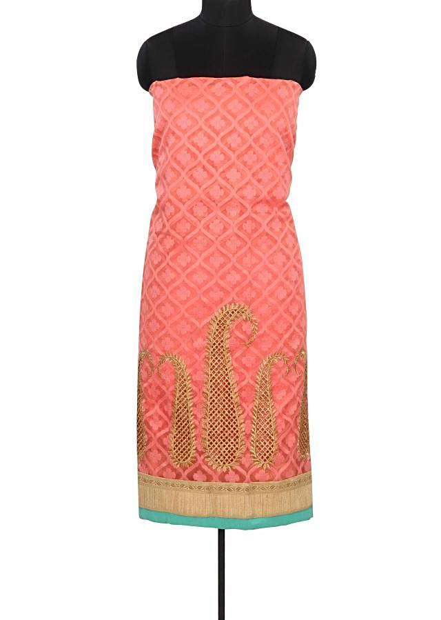Pink unstitched suit enhanced in paisley motif work only on Kalki