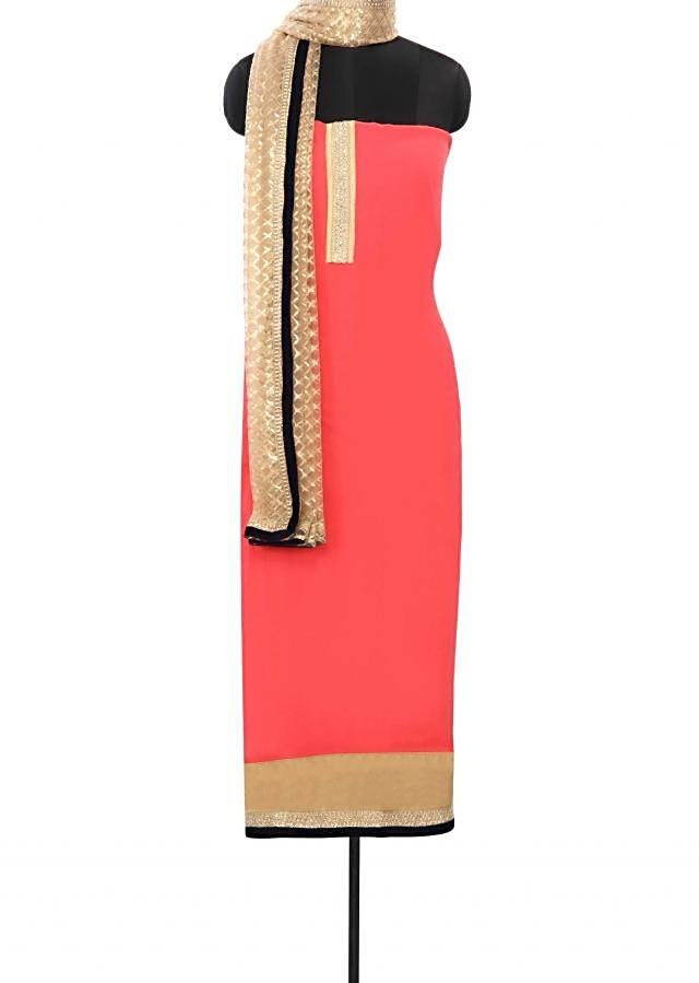 Pink unstitched suit enhanced in sequin and kundan work only on Kalki