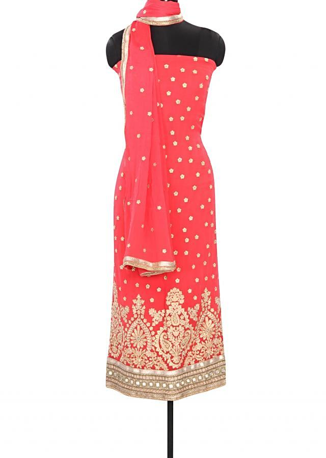 Pink unstitched suit featuring with paisley motif embroidery only on Kalki
