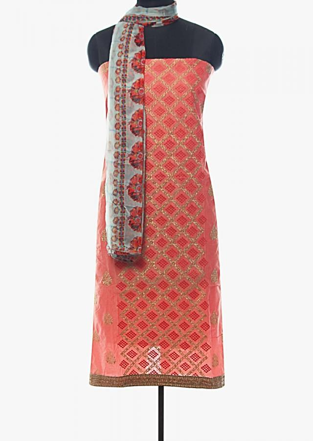 Pink unstitched suit in resham and zari work in jaal and butti motif only on Kalki