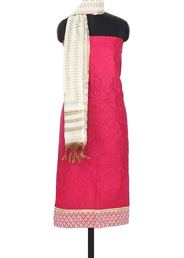 Pink unstitched suit in thread and printed hem line only on Kalki
