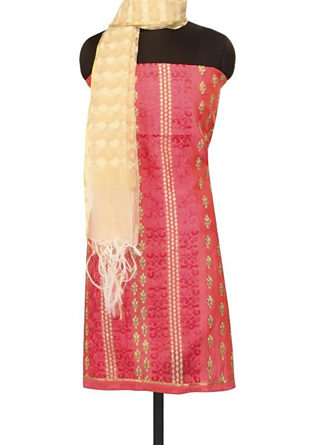 Pink unstithced suit adorn in resham and zari embroidery only on Kalki