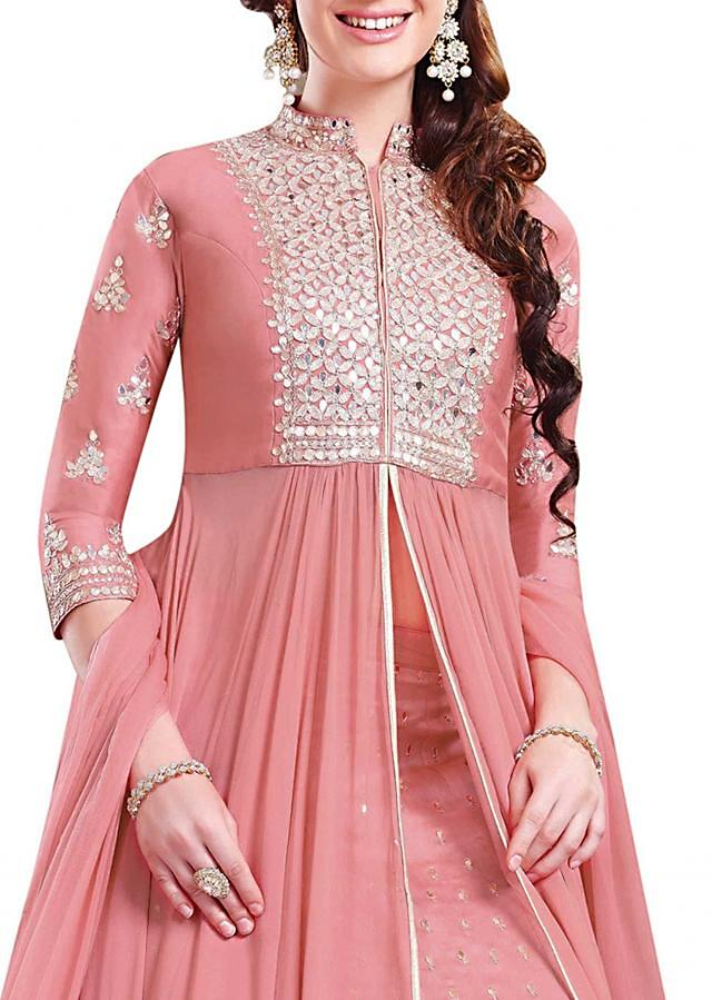 Pink top and lehenga in cotton silk flaunting the patch and mirror work embroidery .