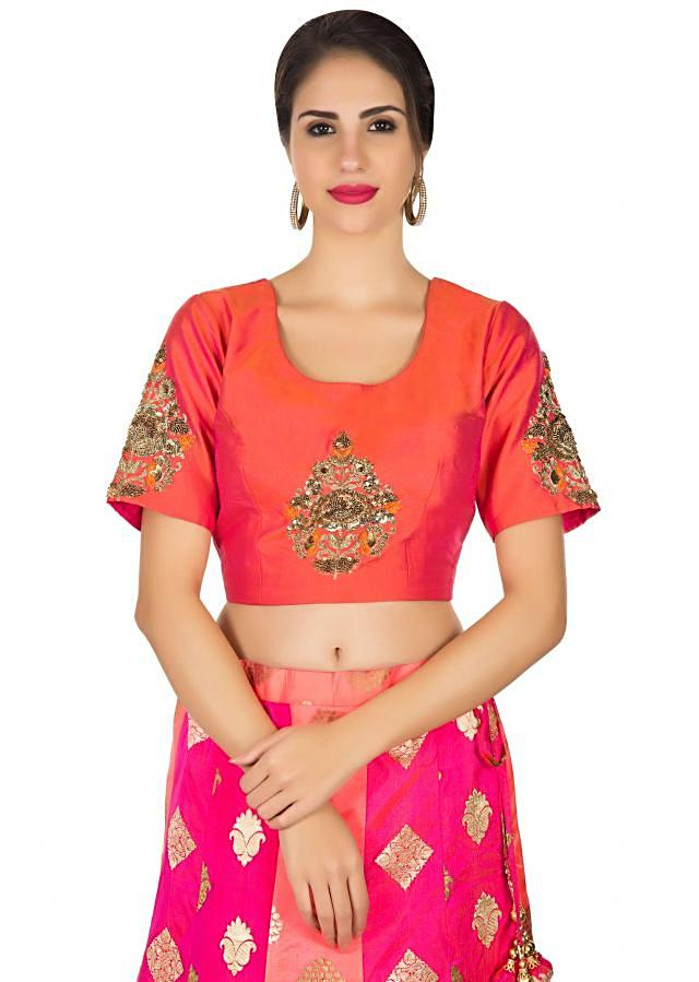 Pink and peach brocade lehenga with orange embroidered ready blouse only on Kalki