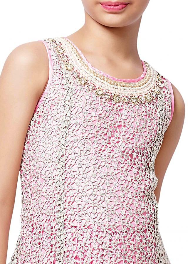 Pink gown features in fancy lace
