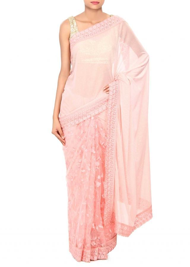 Pink half and half saree enhanced in resham embroidery only on Kalki