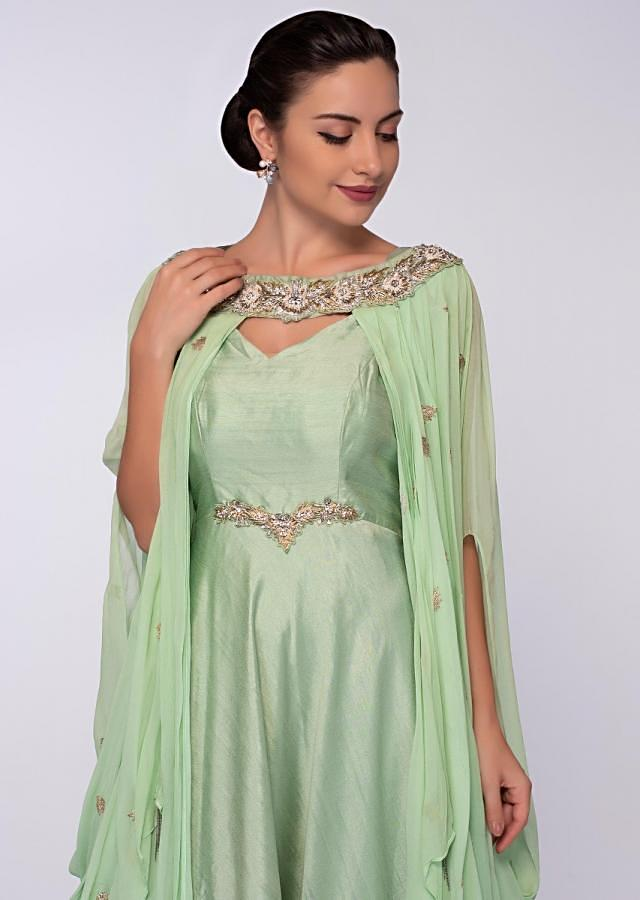 Pista green anarkali gown teamed with a cowl draped wrap around only on Kalki