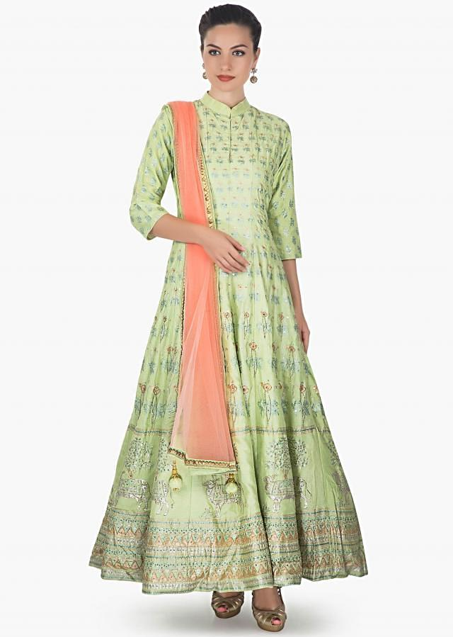 Pista green cotton silk anarkali paired with a peach net dupatta and lycra chudidar only on kalki