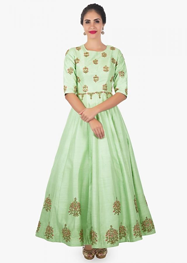 Pista green georgette anarkali paired with contrasting pink net dupatta only on Kalki