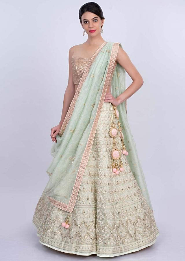 Pista green jute lehenga intricated in thread embroidery and butti only on Kalki