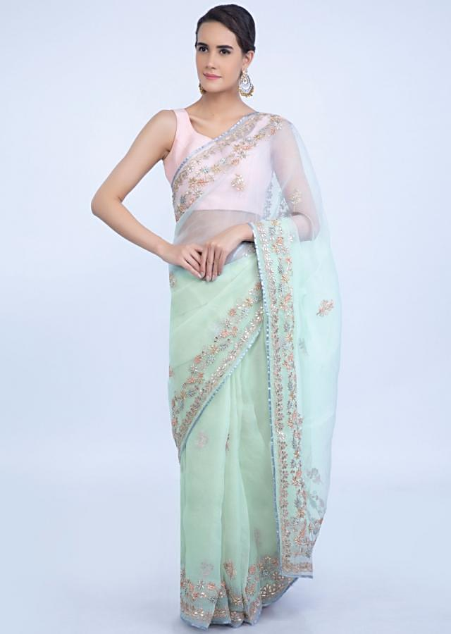 Pista green organza saree with floral embellished butti and border only on Kalki