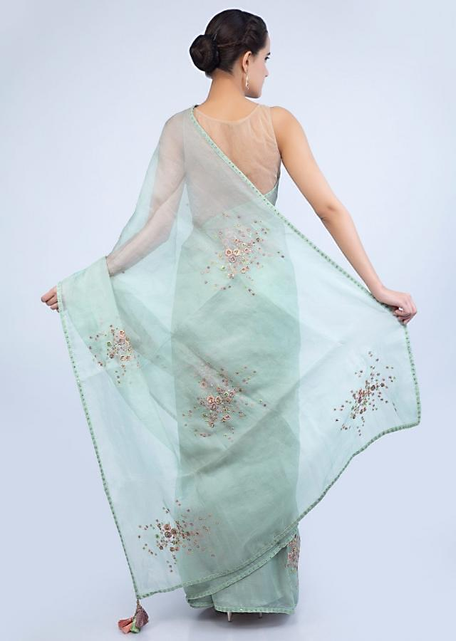 Pista green organza saree with floral embroidered butti only on Kalki