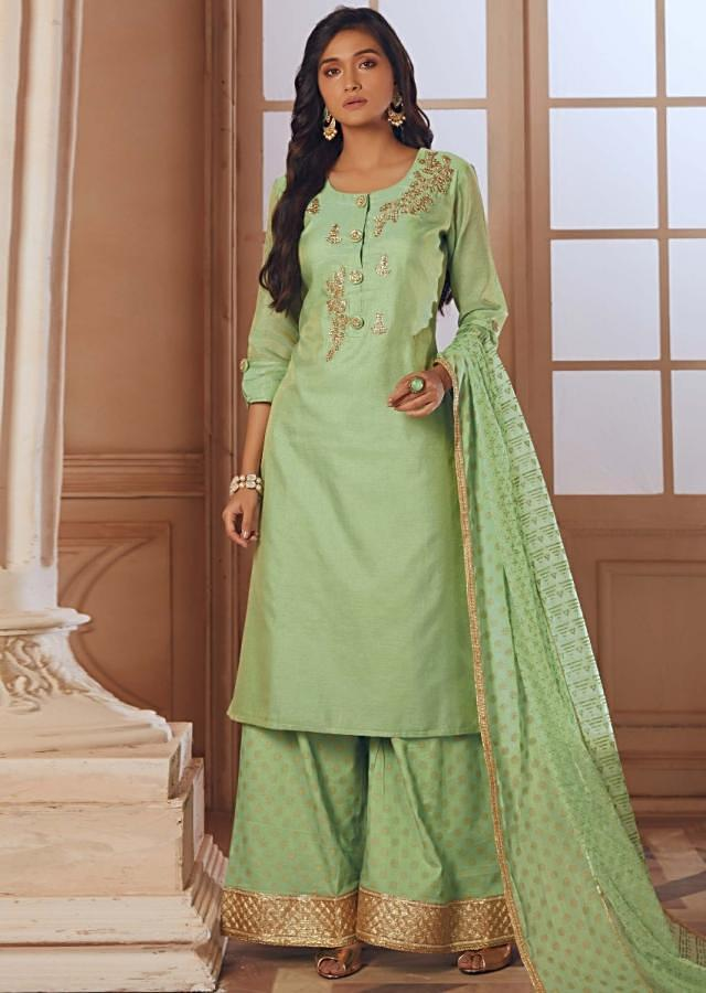 Pista green palazzo suit in silk with embroidered butti and fancy buttons