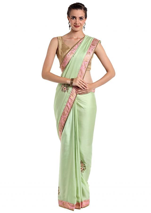 Pista green raw silk saree crafted with zardosi butti and pearls only on Kalki