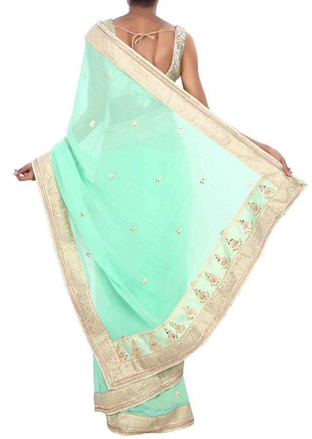 Fresh green saree adorn in gotta patch and lace work only on Kalki