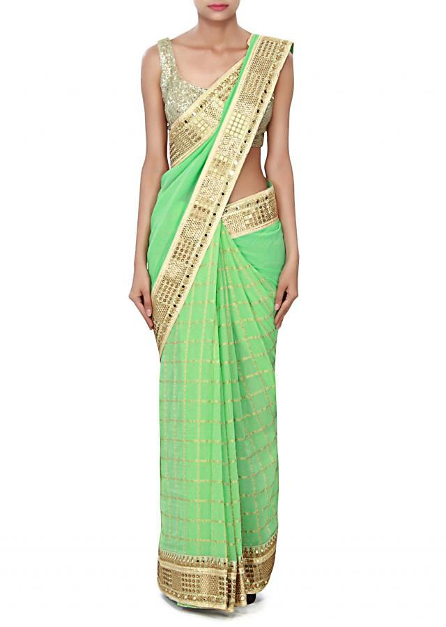 Pista green saree adorn in mirror and foil print only on Kalki
