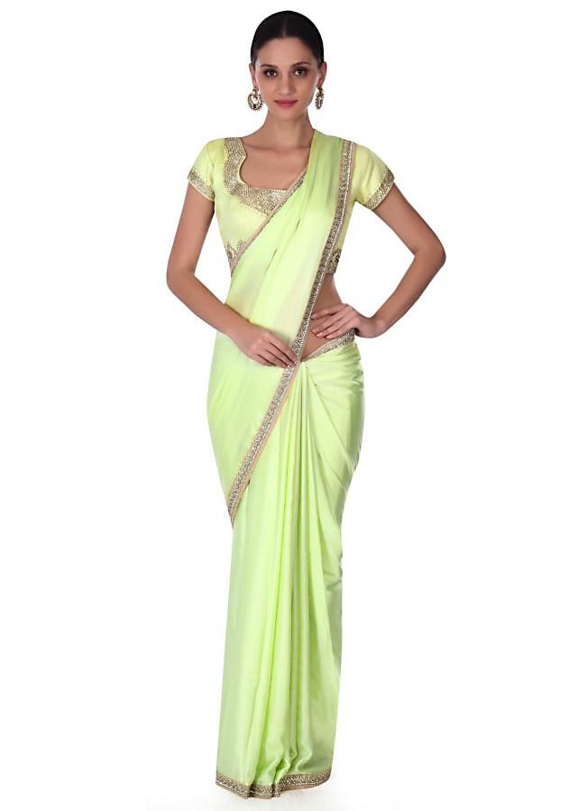 Lime green saree in kundan embroidery only on Kalki