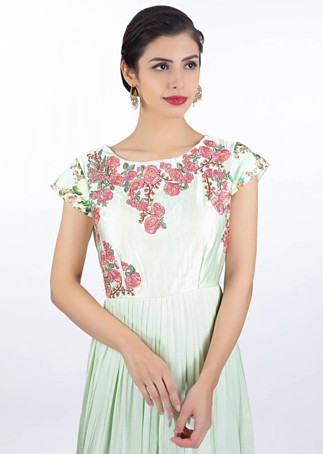Pista green satin crepe dress in floral embroidery paired with long printed jacket only on Kalki