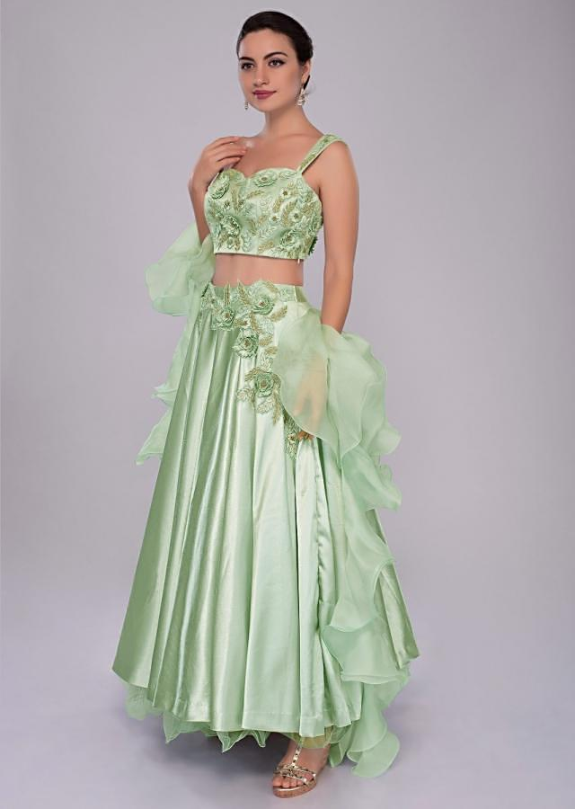 Pista green satin crepe lehenga and embroidered crop top with organza ruffled dupatta only on Kalki