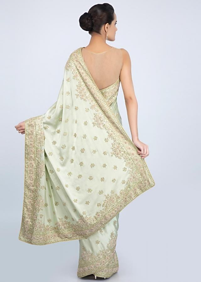 Pista green satin saree with embroidery and butti only on Kalki