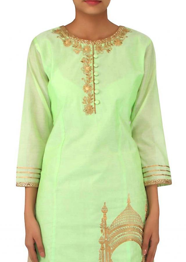 Pista green straight suit in tomb motif embroidery only on Kalki