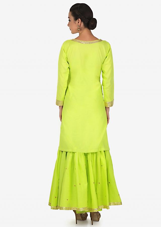 Pista green straight suit with sharara pant adorn in gotta lace only on Kalki
