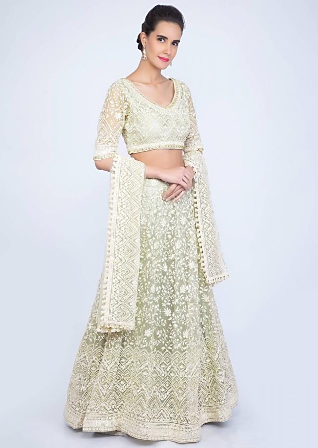 Pista green thread embroidered net lehenga set along with moti and stone work only on kalki