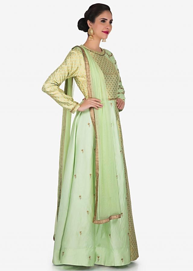 Pista anarkali suit in silk is adorn in foil print and zari embroidery work only on Kalki